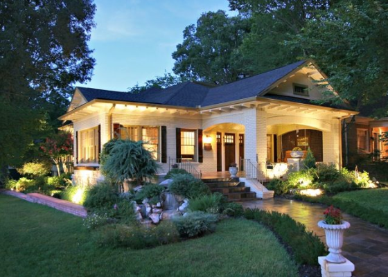 A well lit and beautifully landscaped home.