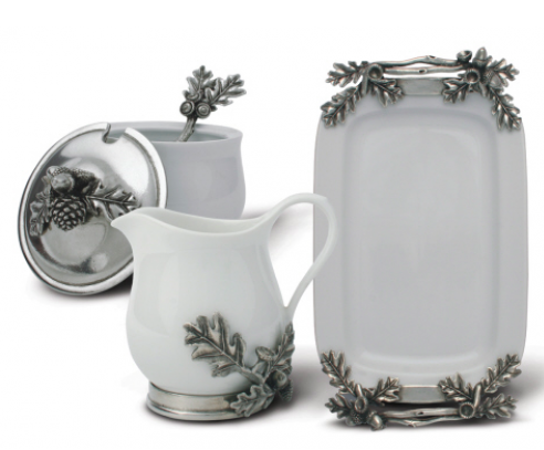 Wintery white porcelain accented with elegant silvery pewter oak leaves and acorns creates an elegant presentation for cream and sugar.