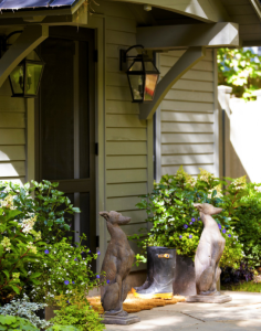 Thom Filicia uses these whippet statues to flank the entry of a home.